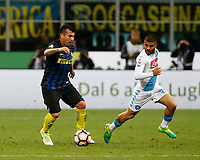 Gary Medel if Inter and Napoli's Lorenzo Insigne  during the  italian serie a soccer match,between Inter FC  and SSC Napoli      at  the San Siro   stadium in Milan  Italy , April  30, 2017
