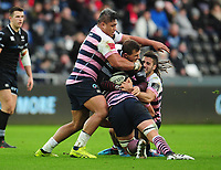Ospreys' Ashley Beck is tackled by Cardiff Blues&rsquo; Nick Williams, Olly Robinson and Josh Navidi<br /> <br /> Photographer Kevin Barnes/CameraSport<br /> <br /> Guinness Pro14 Round 13 - Ospreys v Cardiff Blues - Saturday 6th January 2018 - Liberty Stadium - Swansea<br /> <br /> World Copyright &copy; 2018 CameraSport. All rights reserved. 43 Linden Ave. Countesthorpe. Leicester. England. LE8 5PG - Tel: +44 (0) 116 277 4147 - admin@camerasport.com - www.camerasport.com