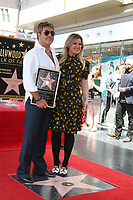 LOS ANGELES - AUG 22:  Simon Cowell, Kelly Clarkson at the Simon Cowell Star Ceremony on the Hollywood Walk of Fame on August 22, 2018 in Los Angeles, CA
