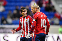 Erick Torres (9) of Chivas USA talks with Adolfo Bautista (10). The New York Red Bulls and Chivas USA played to a 1-1 tie during a Major League Soccer (MLS) match at Red Bull Arena in Harrison, NJ, on March 30, 2014.