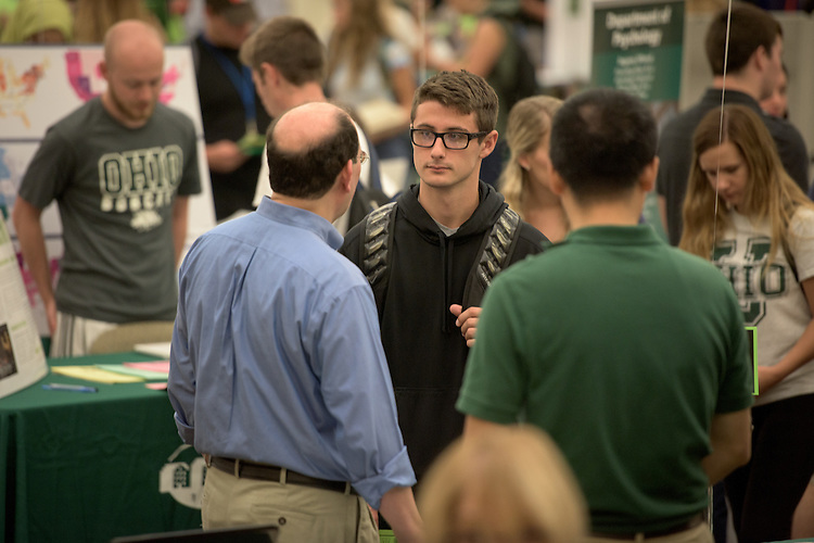 Dr. David Tees, Associate Professor of Ohio University's Physics and Astronomy Department, speaks with Jake Butler, a high school student from Cincinnati, during the 2016 Ohio University Majors Fair held at the Baker Center Ballroom on Wednesday, September 14, 2016.