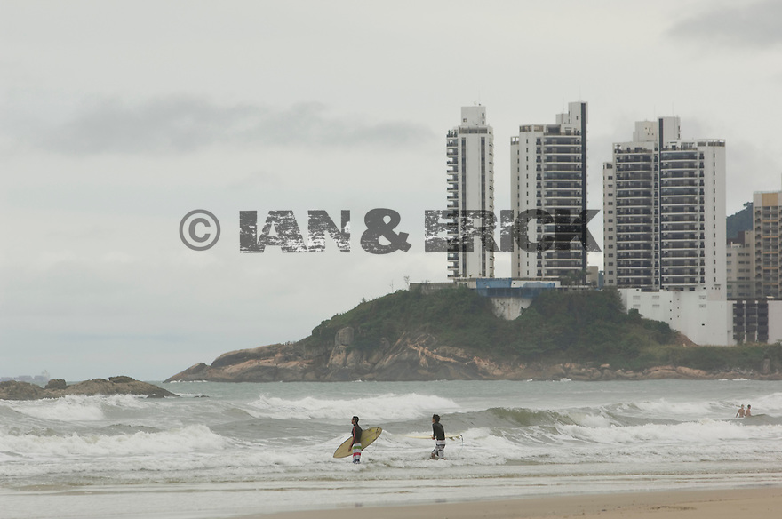 Surfers going out in Guaruja, Brazil.
