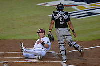 Oct 11, 2007; Phoenix, AZ, USA; Arizona Diamondbacks shortstop (6) Stephen Drew slides into home plate to score off an RBI double hit by left fielder (22) Eric Byrnes in the first inning against the Colorado Rockies during game 1 of the 2007 National League Championship Series at Chase Field. Mandatory Credit: Mark J. Rebilas-US PRESSWIRE