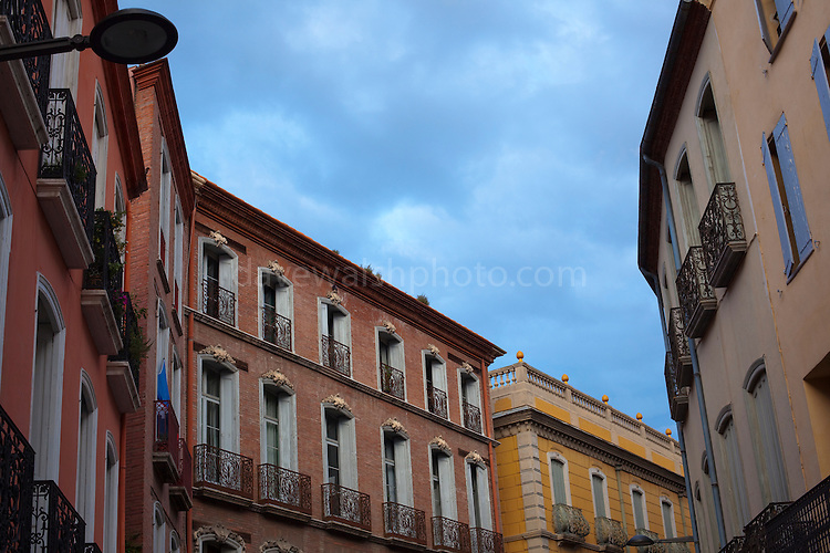 The tops of city houses on the Rue Emile Zola, Perpignan, France