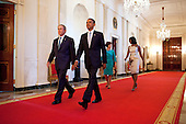 President Barack Obama and First Lady Michelle Obama walk with former President George W. Bush and former First Lady Laura Bush   in the Cross Hall towards the East Room of the White House, May 31, 2012. The President and First Lady hosted a ceremony to unveil the Bushes' official portraits, which will be displayed in the White House. .Mandatory Credit: Chuck Kennedy - White House via CNP
