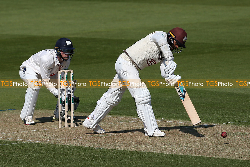 Ryan Patel in batting action for Surrey as Robbie White looks on from behind the stumps during Surrey CCC vs Essex CCC, Specsavers County Championship Division 1 Cricket at the Kia Oval on 11th April 2019