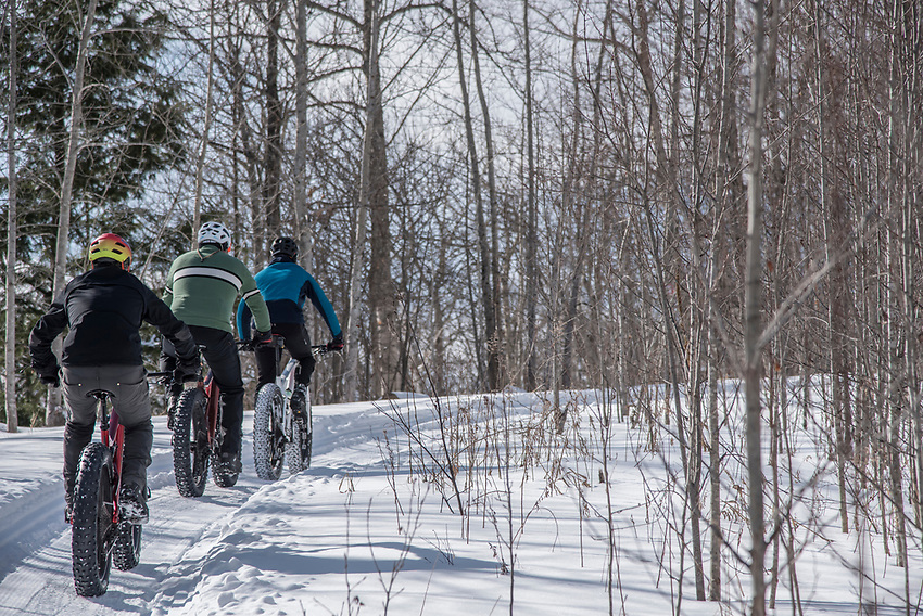 Climbing the Benson Grade trail on the Snow Bike Route of Marquette, Michigan.