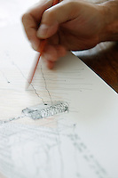 A close up of architect Thomas Fourtane drawing