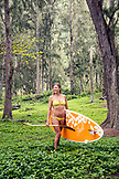 USA, Hawaii, The Big Island, portrait of paddle boarder Donica Shouse in the lush Waipio Valley