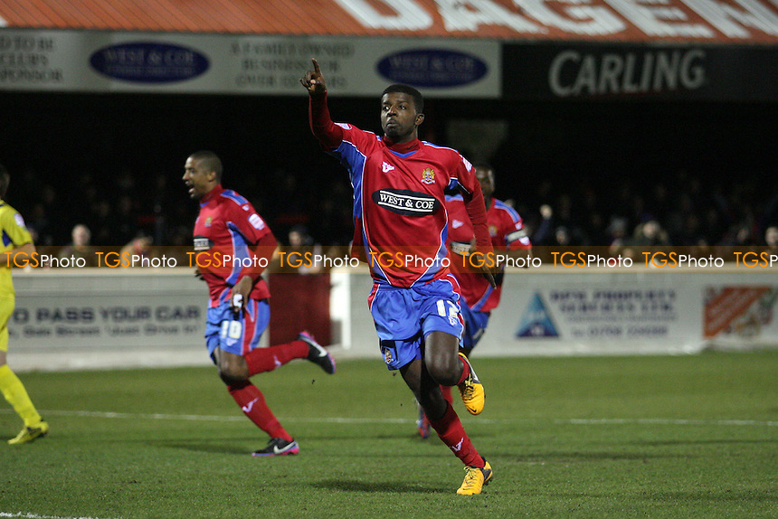 Medy Elito of Dagenham celebrates scoring from the penalty spot - Dagenham and Redbridge vs Torquay United at the London Borough of Barking and Dagenham Stadium - 12/03/13 - MANDATORY CREDIT: Dave Simpson/TGSPHOTO - Self billing applies where appropriate - 0845 094 6026 - contact@tgsphoto.co.uk - NO UNPAID USE.