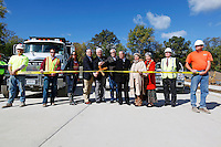 From left, Fronabarger Concreters' Chris Nance and David McMullin, city council members Meg Davis Proffer and John Voss, Mayor Harry Rediger, Isle vice president of design and construction Dick Meister, Isle Chief Operating Officer Arnold Block, city council members Loretta Schneider and Debra Tracy, KDG Architects' Ron Pagan and Fronabarger Concreters' Kendall Miller cut the construction tape to reopen Main St. in Cape Girardeau, Mo., on Thursday, Oct. 20, 2011. Main Street officially reopened to traffic Thursday after being closed to the public since March to reroute the road around the Isle of Capri Cape Girardeau casino site.