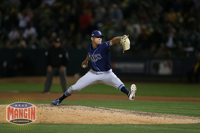 OAKLAND, CA - OCTOBER 02:  Emilio Pagan #15 of the Tampa Bay Rays pitches against the Oakland Athletics during the American League Wild Card Game at RingCentral Coliseum on Wednesday, October 2, 2019 in Oakland, California. (Photo by Brad Mangin)