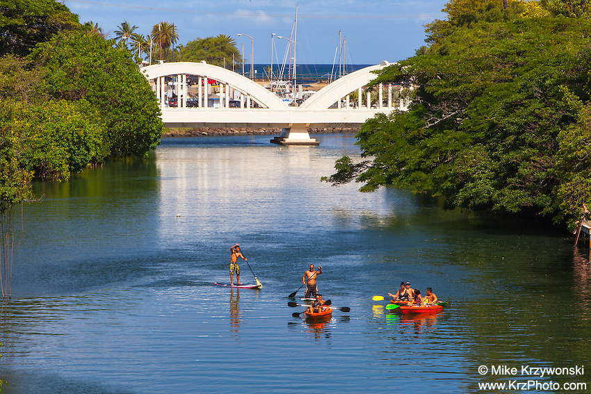 Stand-up Paddleboarders & kayakers on Anahulu Stream in Haleiwa, North Shore, Oahu, Hawaii