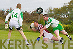 John Mike Foley Cromane uses his head to gather the ball ahead of Jim Cremin Ballydonohue during their league game in Cromane on Sunday