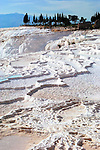 Hot springs bubble up from the earth, forming otherworldly natural pools and travertine terraces at Pamukkale, Turkey