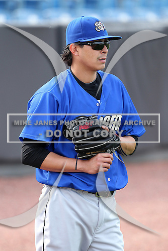 Omaha Storm Chasers pitcher Jesse Chavez #30 throws in the outfield during batting practice before a game against the Nashville Sounds at Greer Stadium on April 25, 2011 in Nashville, Tennessee.  Omaha defeated Nashville 2-1.  Photo By Mike Janes/Four Seam Images