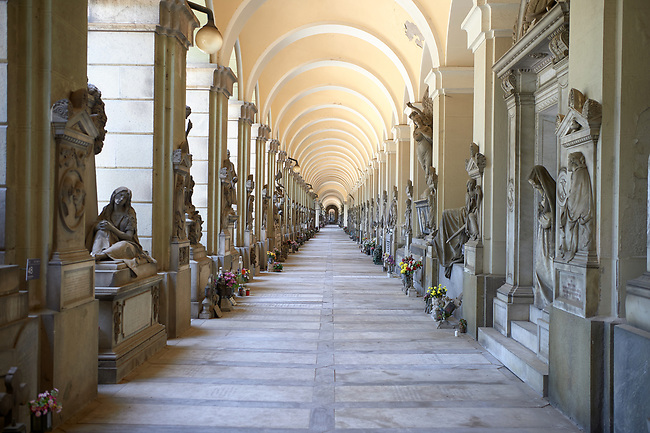 Picture and image of the stone sculptured monumental tombs of lower arcade of the Staglieno Monumental Cemetery, Genoa, Italy