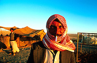 Syria, El Haseke, Sept. 1989..Nomad man posing in front of their summer tent in the far North East of Syria...Nomaad voor de zomer tent in het verre Noord-Oosten van Syrie...Photo  Kees Metselaar