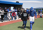 Western Nevada College's Sam Hall escorts his mom onto the field for Sophomore Day festivities at John L. Harvey field, on Sunday, April 27, 2014, in Carson City, Nev.<br /> Photo by Cathleen Allison/Nevada Photo Source
