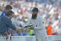 England's Moeen Ali signs autographs during a break in play<br /> <br /> Photographer Stephen White/CameraSport<br /> <br /> Investec Test Series 2017 - Second Test - England v South Africa - Day 3 - Sunday 16th July 2017 - Trent Bridge - Nottingham<br /> <br /> World Copyright &copy; 2017 CameraSport. All rights reserved. 43 Linden Ave. Countesthorpe. Leicester. England. LE8 5PG - Tel: +44 (0) 116 277 4147 - admin@camerasport.com - www.camerasport.com