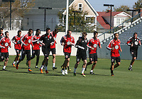 Chad Ashton assistant coach of D.C. United leads a jog during a training session in Hapgood Stadium on the campus of the Citadel,on March 11 2011, in Charleston, South Carolina