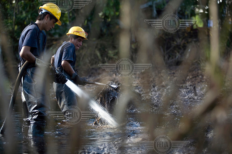 Workers clean up a pool of crude oil and waste left behind by Texaco's operations at well Lago Agrio 11. A class action lawsuit was brought against US multinational oil giant Texaco (acquired by Chevron in 2001) by more than 30,000 Ecuadorians. The case has been in the Ecuadorian courts since 2003 and relates to the dumping of billions of gallons of toxic materials into unlined pits and Amazonian rivers. In February 2011 the court ruled that Chevron should pay a fine totalling 9.5 billion USD. However, Chevron has stated that the ruling is 'illegitimate and unenforceable' and has started numerous counter proceedings in US courts. There is some doubt as to whether it will be possible to force Texaco to pay the fine.