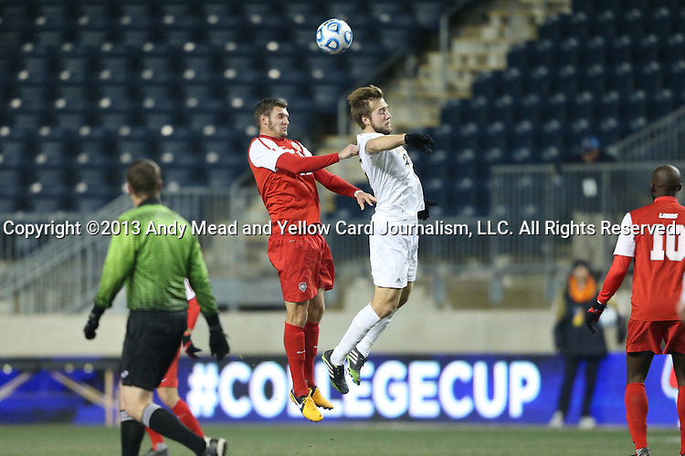 13 December 2013: Notre Dame's Vince Cicciarelli (right) and New Mexico's Kyle Venter (left) challenge for a header. The University of Notre Dame Fighting Irish played the University of New Mexico Lobos at PPL Park in Chester, Pennsylvania in a 2013 NCAA Division I Men's College Cup semifinal match. Notre Dame won the game 2-0.