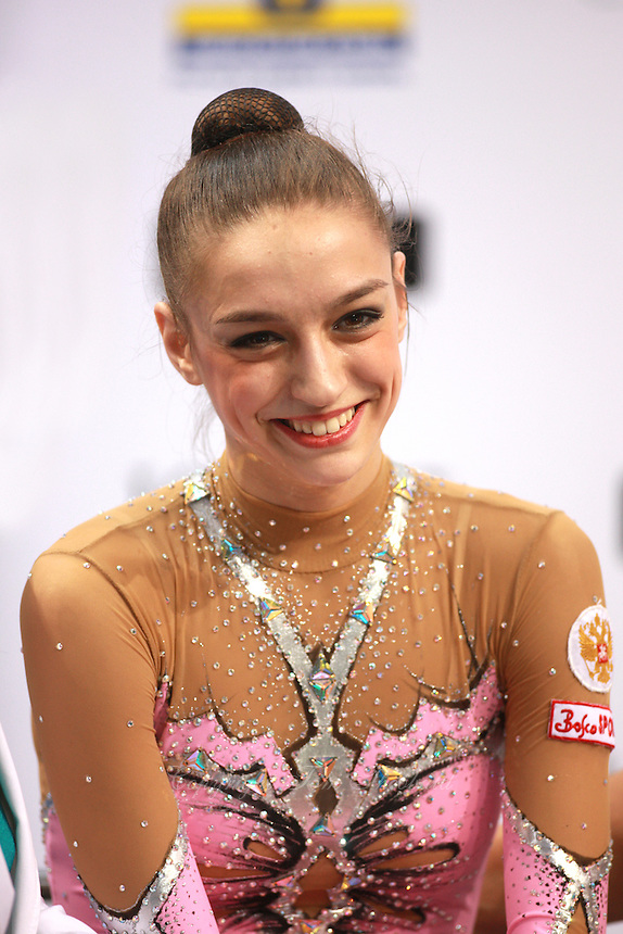 "Evgenia Kanaeva of Russia smiles at ""kiss & cry"" on way to winning All-Around gold at 2008 European Championships at Torino, Italy on June 6, 2008.  Photo by Tom Theobald."