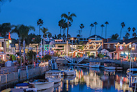 Naples Canals; Belmont Shore; Long Beach; CA, Luxury; Houses, Lit, Blue Sky, Water Reflections,