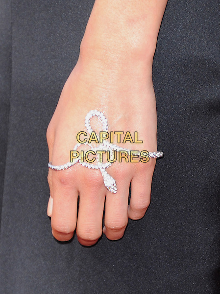 "Jamie Chung's hand.""The Hangover Part III"" Los Angeles Premiere held at the Westwood Village Theater, Los Angeles, California, USA..May 20th, 2013.bracelet snake silver black wrist jewellery jewelry diamonds   detail.CAP/DVS.©DVS/Capital Pictures"