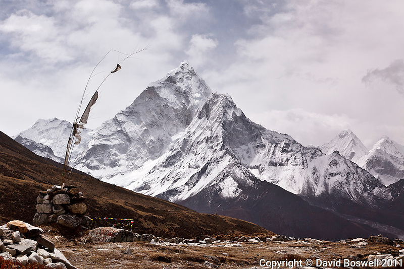 The peak of Ama Dablam (22,349 ft./6812 m.) and the remnants of prayer flags seen in the Khumbu Valley on the trail to Everest Base Camp.