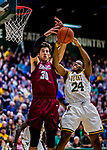 8 December 2018: University of Vermont Guard Ben Shungu, a Redshirt Sophomore from Burlington, VT, goes up against Harvard University Crimson Forward Danilo Djuricic, a Sophomore from Brampton, Ontario, in first half action at Patrick Gymnasium in Burlington, Vermont. The America East Catamounts overcame a 10-point 2nd half deficit, to defeat the Ivy League Crimson 71-65 in NCAA Division I inter-league play. Mandatory Credit: Ed Wolfstein Photo *** RAW (NEF) Image File Available ***
