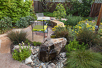Weeping rock water feature by patio in Habets garden, Pleasant Hill, California
