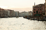 ITALY, Venice. View of the Grand Canal, Homes, Shops and Restaurants at sunset.