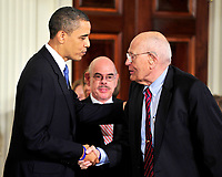Washington, D.C. - March 23, 2010 -- United States President Barack Obama, left, shakes hands with U.S. Representative John Dingell (Democrat of Michigan), right, as he prepares to sign the version of the health care bill that was passed by the U.S. House of Representatives in the East Room of the White House in Washington, D.C. on Tuesday, March 23, 2010.  Dingell is the longest-serving member of the U.S. House and has been fighting for health care reform for the past half-century. Credit: Ron Sachs/CNP/AdMedia