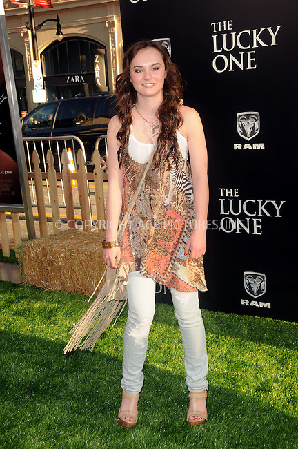 WWW.ACEPIXS.COM . . . . .  ....April 16 2012, LA....Madeline Carroll arriving at the premiere  of  'The Lucky One' at Grauman's Chinese Theatre on April 16, 2012 in Hollywood, California....Please byline: PETER WEST - ACE PICTURES.... *** ***..Ace Pictures, Inc:  ..Philip Vaughan (212) 243-8787 or (646) 769 0430..e-mail: info@acepixs.com..web: http://www.acepixs.com