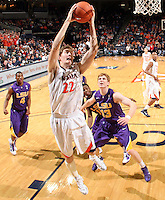 Jan. 2, 2011; Charlottesville, VA, USA; Virginia Cavaliers forward Will Sherrill (22) grabs a rebound in front of LSU Tigers forward Eddie Ludwig (13) and LSU Tigers guard Chris Bass (4) during the game at the John Paul Jones Arena. Virginia won 64-50. Mandatory Credit: Andrew Shurtleff-