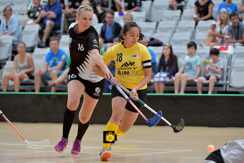 Malaysia's Pei Yi Cheah and New Zealand's Nicolette Jones in action during the World Floorball Championships 2017 Qualification for Asia Oceania Region - New Zealand v Malaysia at ASB Sports Centre , Wellington, New Zealand on Saturday 4 February 2017.<br /> Photo by Masanori Udagawa<br /> www.photowellington.photoshelter.com.