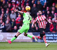 Forest Green Rovers' Carl Winchester clears under pressure from Lincoln City's Bruno Andrade<br /> <br /> Photographer Andrew Vaughan/CameraSport<br /> <br /> The EFL Sky Bet League Two - Lincoln City v Forest Green Rovers - Saturday 3rd November 2018 - Sincil Bank - Lincoln<br /> <br /> World Copyright &copy; 2018 CameraSport. All rights reserved. 43 Linden Ave. Countesthorpe. Leicester. England. LE8 5PG - Tel: +44 (0) 116 277 4147 - admin@camerasport.com - www.camerasport.com