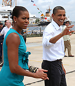 United States President Barack Obama and First Lady Michelle walk by reporters after speaking at a Coast Guard base in Panama City, Florida USA on Saturday, 14 August  2010. The First Family is visiting the area to help promote tourism and check up on clean up efforts from the aftermath of the Deepwater Horizon Oil spill. .Credit: Dan Anderson / Pool via CNP
