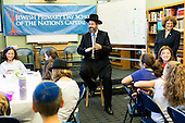 "Israel's Ashkenazi Chief Rabbi David Lau, visits the Jewish Primary Day School of the Nation's Capital in Washington, DC Friday, Oct. 16.  Meeting with fourth, fifth and sixth grade classes of the Jewish community day school, Lau spoke about the connectedness of all Jewish people, addressing the students as his young ""brother and sisters."" Students had the opportunity to share with the Rabbi what they are learning, ranging from the kindness of the biblical Rebecca at the well, to the later history of the kingdoms of Judea and Israel, and the still later expulsion of the Jews from Spain. Upon receiving the book ""Jewish Washington: Scrapbook of an American Community"" from the school, Rabbi Lau said, ""I hope that one day they will add a page to this book about you, because you are Jewish life in this city.""  Lau also visited the Torah School of Greater Washington in Silver Spring, MD.  <br /> Mandatory Credit: Moshe Zusman via CNP"