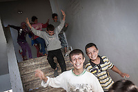 In this Thursday, Sep. 26, 2013 photo, Syrian children run downstairs at the public school in Madaya village as classes started in the Idlib province countryside of Syria. Children have come back to school in the rebel controlled territory despite the constant threaten of shelling and the ongoing fighting, and public schools still operating financially under the Syrian government administration. (AP Photo)