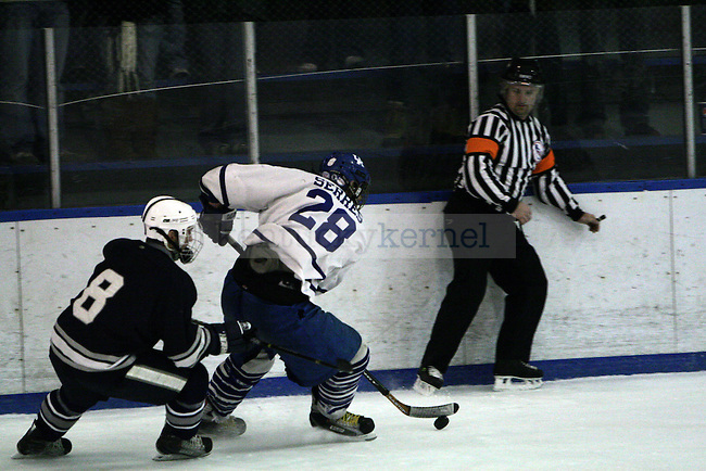Andrew Serres with the puck against Penn State Saturday night. Photo by William Baldon