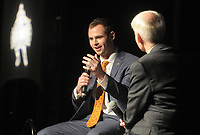 NWA Democrat-Gazette/DAVID GOTTSCHALK Hunter Renfrow (left), wide receiver at Clemson University, speaks with Rick Schaeffer, director of communications with the Springdale School District, Monday, December 3, 2018, before receiving the 2018 Burlsworth Trophy at the Northwest Arkansas Convention Center in Springdale. The national award is named after Brandon Burlsworth, a former walk-on at the University of Arkansas, and honors the athletic accomplishments of the walk-on student athlete.