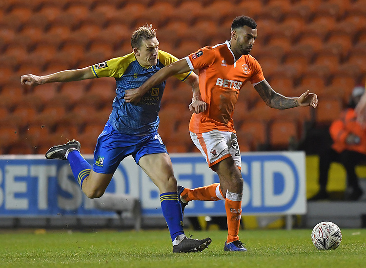 Blackpool's Curtis Tilt battles with Solihull Moors' Danny Wright<br /> <br /> Photographer Dave Howarth/CameraSport<br /> <br /> The Emirates FA Cup Second Round Replay - Blackpool v Solihull Moors - Tuesday 18th December 2018 - Bloomfield Road - Blackpool<br />  <br /> World Copyright © 2018 CameraSport. All rights reserved. 43 Linden Ave. Countesthorpe. Leicester. England. LE8 5PG - Tel: +44 (0) 116 277 4147 - admin@camerasport.com - www.camerasport.com