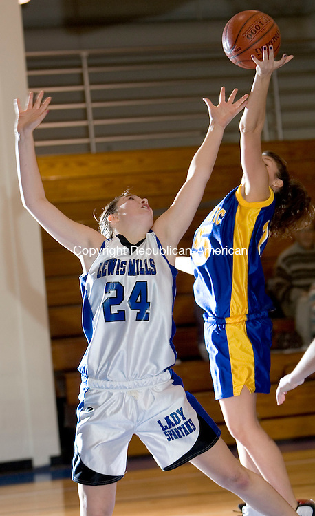 BURLINGTON, CT- 11 JAN 2008- 011108JT10-<br /> Housatonic's Kayla Robinson, right, and Lewis Mills' Aubrey Hoyt jump for a rebound during Friday's game at Lewis Mills. Mills won 58-47.<br /> Josalee Thrift / Republican-American