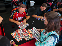 Sep 1, 2018; Clermont, IN, USA; NHRA top fuel driver Doug Kalitta signs autographs during qualifying for the US Nationals at Lucas Oil Raceway. Mandatory Credit: Mark J. Rebilas-USA TODAY Sports