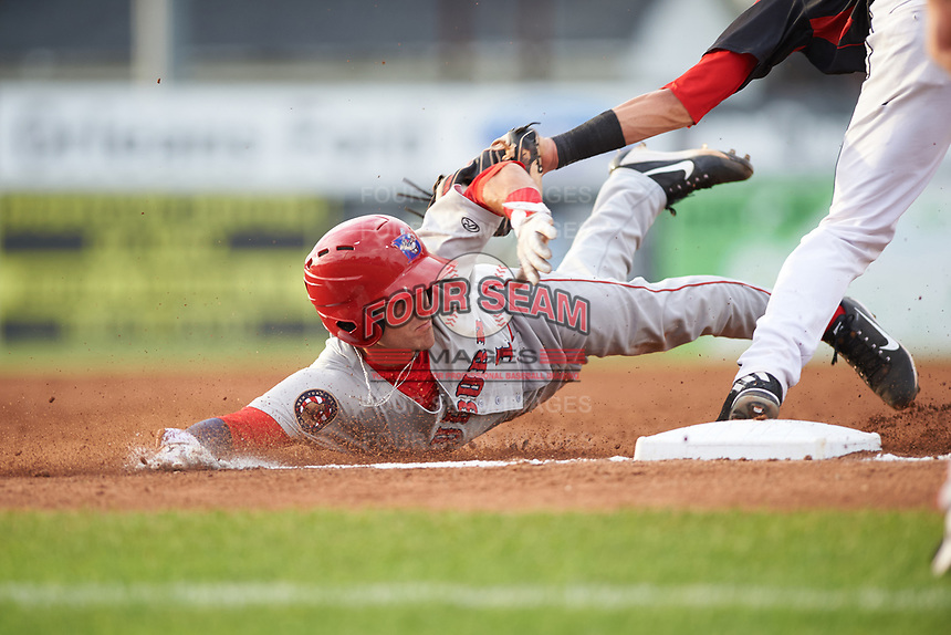 Auburn Doubledays shortstop Ryan Merrill (1) is tagged out by Tyler Curtis (right) while sliding into third base after tagging up on a fly ball in the top of the third inning during a game against the Batavia Muckdogs on July 6, 2017 at Dwyer Stadium in Batavia, New York.  Auburn defeated Batavia 4-3.  (Mike Janes/Four Seam Images)