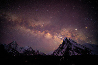 The star filled sky and Milky Way above G4 and other giant peaks of the Karakoram, Pakistan.
