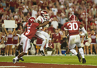 Hawgs Illustrated/BEN GOFF <br /> Jordan Jones, Arkansas wide receiver, catches a touchdown pass as Alabama cornerbacks Shyheim Carter (5) and Trevon Diggs (7) make the tackle in the fourth quarter Saturday, Oct. 14, 2017, at Bryant-Denny Stadium in Tuscaloosa, Ala.